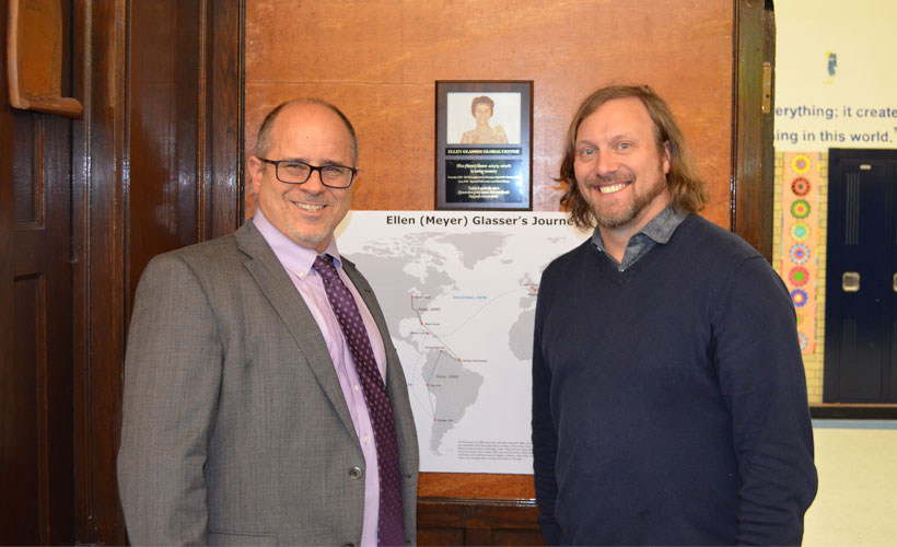 Mike Glasser and Chad Adams with memorial placque to Ellen Glasser