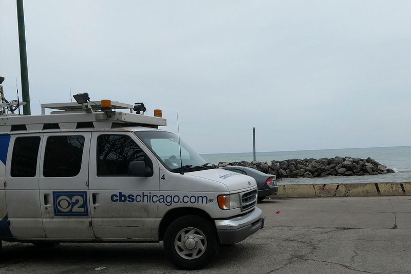 "CBS 2 Chicago van at Jarvis Beach to film ""Fake News"" story"