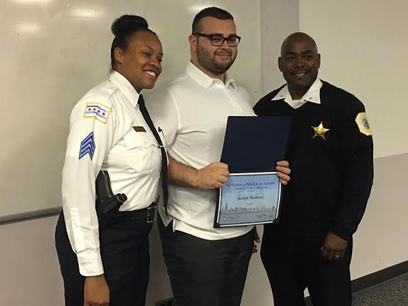 Joseph Mathews receives diploma as one of the first graduates from Citizen's Police Academy